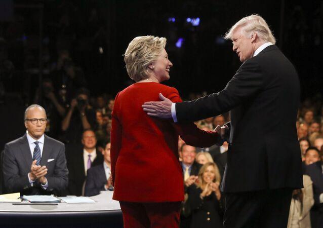 In this Sept. 26, 2016 file photo, Democratic presidential nominee Hillary Clinton and Republican presidential nominee Donald Trump shake hands during the presidential debate at Hofstra University in Hempstead, N.Y.