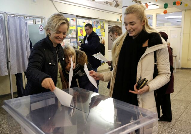People cast their votes during general election in Vilnius, Lithuania, October 9, 2016
