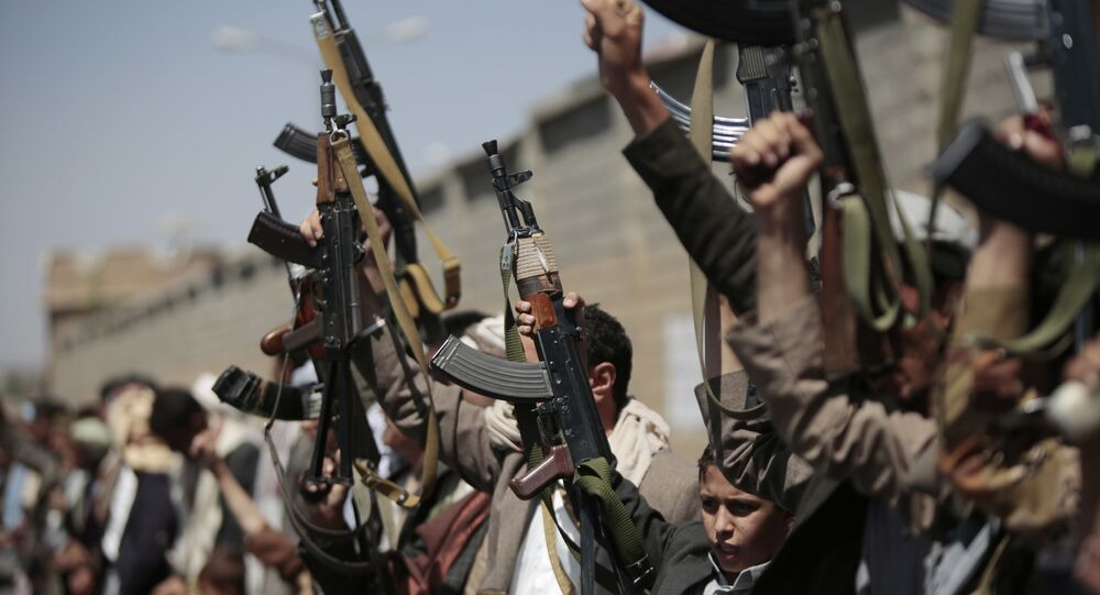 Tribesmen loyal to Houthi rebels, hold their weapons as they chant slogans during a gathering aimed at mobilizing more fighters into battlefronts in several Yemeni cities, in Sanaa, Yemen, Sunday, Oct. 2, 2016