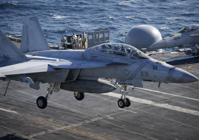 A U.S. Navy F/A-18 Super Hornet fighter lands onto the deck of the USS Ronald Reagan, a Nimitz-class nuclear-powered super carrier, during a joint naval drill between South Korea and the U.S. (File)