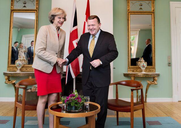 Britain's Prime Minister Theresa May shakes hands with Danish Prime Minister Lars Lokke Rasmussen, at Marienborg estate in Lyngby outside Copenhagen, Denmark, October 10, 2016.