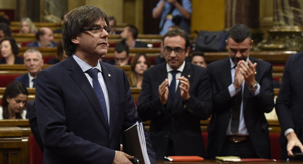 President of the Catalan regional Government Carles Puigdemont leaves after a debate on the government's question of confidence at the Parliament of Catalonia in Barcelona on September 29, 2016
