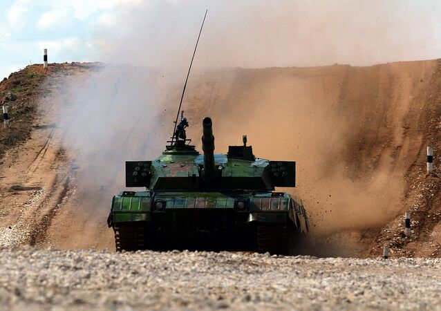 A ZTZ99 Main Battle Tank of China's team competes during 'tank biathlon', a paramilitary international competition with armor races and precision gunnery near Alabino, outside Moscow, on August 4, 2014
