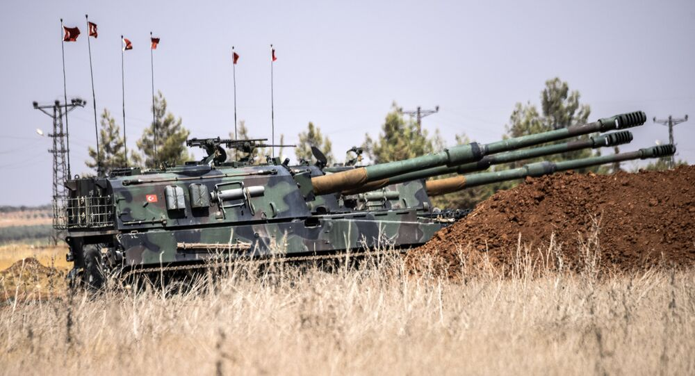 Turkish military tanks are seen during clashes between Turkish soldiers and Islamic State group fighters, 20 km west of the Turkish-Syrian border town of Karkamis, in the southern region of Gaziantep, on September 3, 2016