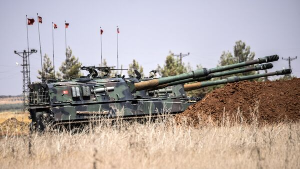 Turkish military tanks are seen during clashes between Turkish soldiers and Islamic State group fighters, 20 km west of the Turkish-Syrian border town of Karkamis, in the southern region of Gaziantep, on September 3, 2016 - Sputnik International