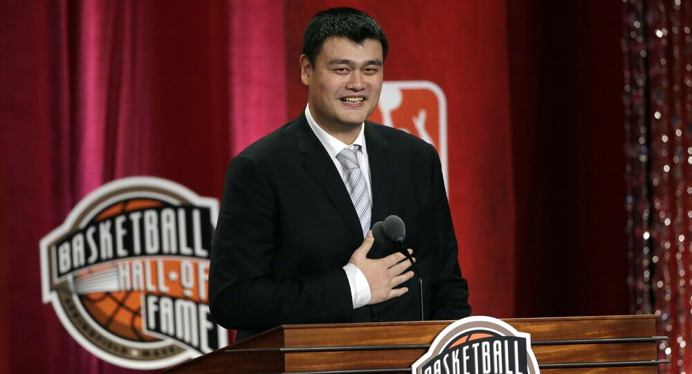 Basketball Hall of Fame indcutee Yao Ming puts his hand on his chest near his heart as he speaks during induction ceremonies, Friday, Sept. 9, 2016, in Springfield, Mass