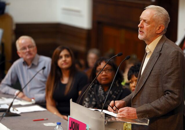 Britain's Opposition Labour Party leader Jeremy Corbyn (R) speaks at a Stand Up To Racism rally in London, Britain October 8, 2016.