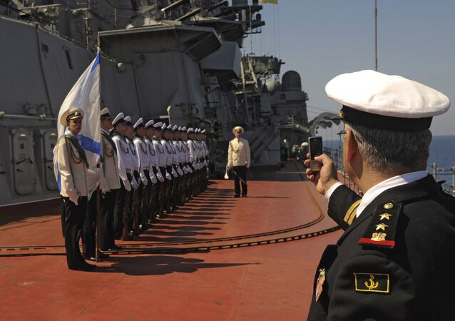 Russia's nuclear-powered missile cruiser Pyotr Veliky navy sailors attend a greeting ceremony for the Russian official delegation at Syria's Mediterranean port of Tartus.File photo