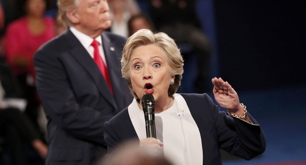 Hillary Clinton speaks during their presidential town hall debate with Donald Trump at Washington University in St. Louis, Missouri, U.S., October 9, 2016.