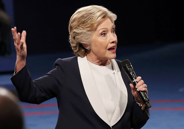 Democratic U.S. presidential nominee Hillary Clinton speaks to members of the audience during the presidential town hall debate with Republican US presidential nominee Donald Trump at Washington University in St. Louis, Missouri, US, October 9, 2016.
