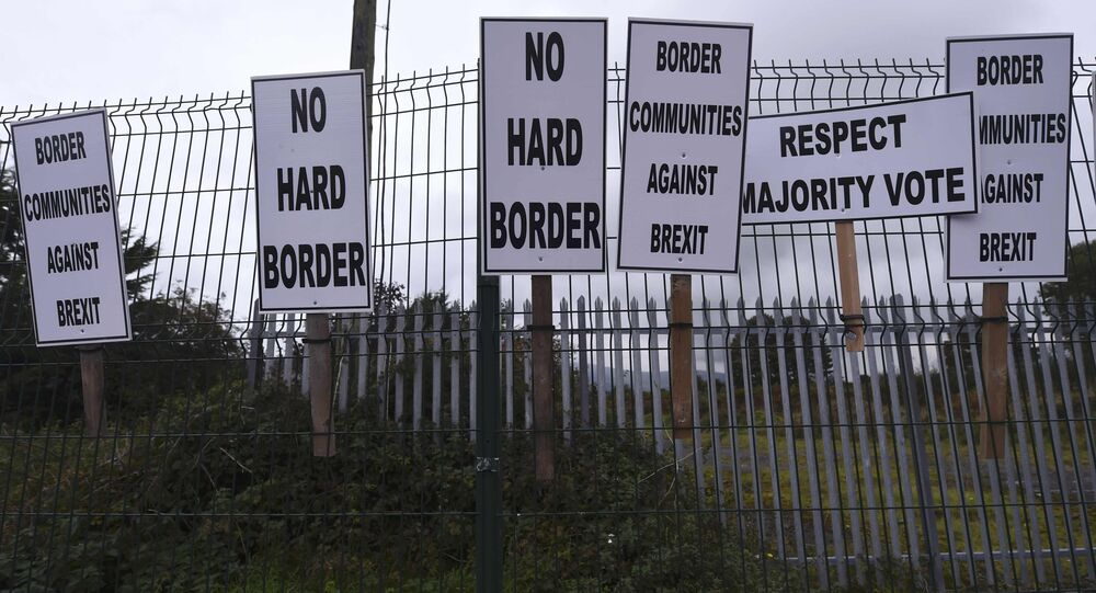 Banners are displayed during a protest by Anti-Brexit campaigners, Borders Against Brexit, against Britain's vote to leave the European Union, at the border town of Carrickcarnon in Ireland October 8, 2016.