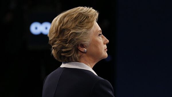 Democratic presidential nominee Hillary Clinton looks on during the second presidential debate at Washington University in St. Louis, Missouri on October 9, 2016. - Sputnik International