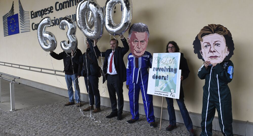 Members of international NGO Transparency International hold balloons reading 63,000, indicating the number of signatures on a petition against Jose Manuel Barosso's decision to work for Goldman Sachs, during a demonstration at the EU Headquarters in Brussels on October 12, 2016.