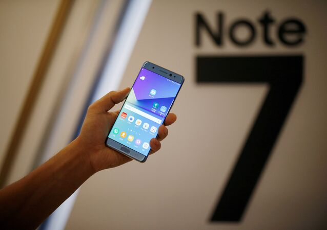 A model poses for photographs with a Galaxy Note 7 new smartphone during its launching ceremony in Seoul, South Korea, August 11, 2016.