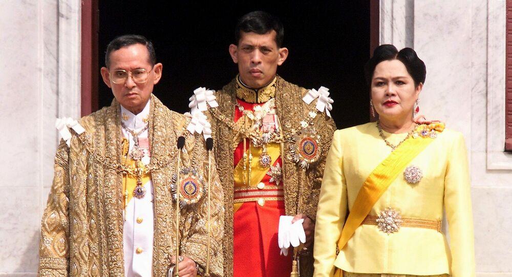 This file photo taken on December 05, 1999 shows (L-R) Thai King Bhumibol Adulyadej, Crown Prince Maha Vajiralongkorn and Queen Sirikit appearing at a balcony of Anantasamakom Throne Hall in Bangkok to mark the King's birthday.