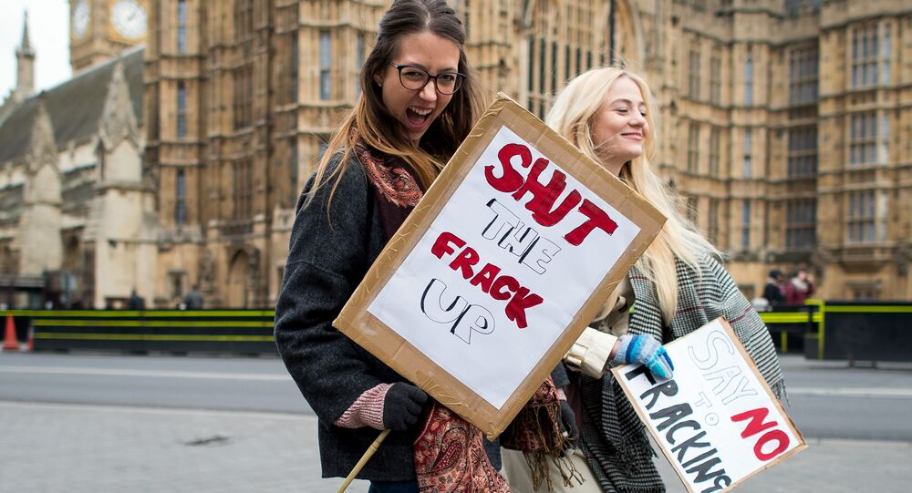 Activists attend an anti-fracking rally outside the Houses of Parliament in central London on January 26, 2015, calling for MPs to vote for a moratorium on fracking within the UK.