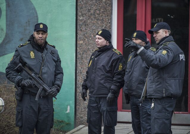 Policemen stand in front of a house in Ishoj, Denmark