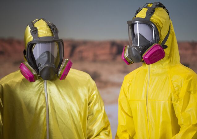 Two yellow Tyvek suits worn by Bryan Cranston and Aaron Paul in the AMC series Breaking Bad are displayed at the National Museum of American History in Washington, DC, November 10, 2015, during a memorabilia donation ceremony.