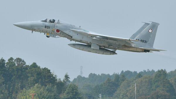 A Japan Air Self-Defense Forces F-15J/DJ takes off - Sputnik International