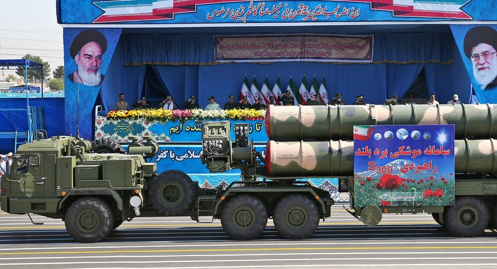 In front of the portraits of supreme leader Ayatollah Ali Khamenei, right, and late revolutionary founder Ayatollah Khomeini, left, a long-range, S-300 missile system is displayed by Iran's army during a military parade marking the 36th anniversary of Iraq's 1980 invasion of Iran, in front of the shrine of late revolutionary founder Ayatollah Khomeini, just outside Tehran, Iran, Wednesday, Sept. 21, 2016
