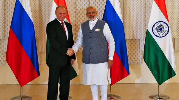 Russian President Vladimir Putin (L) shakes hand with India's Prime Minister Narendra Modi during a photo opportunity ahead of India-Russia Annual Summit in Benaulim, in the western state of Goa, India, October 15, 2016 - Sputnik International