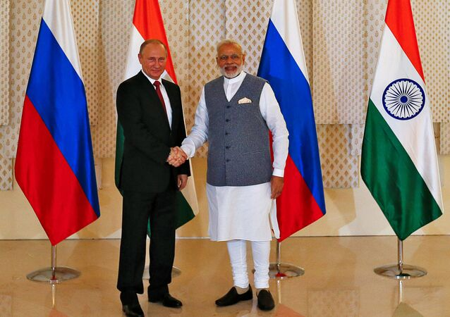 Russian President Vladimir Putin (L) shakes hand with India's Prime Minister Narendra Modi during a photo opportunity ahead of India-Russia Annual Summit in Benaulim, in the western state of Goa, India, October 15, 2016
