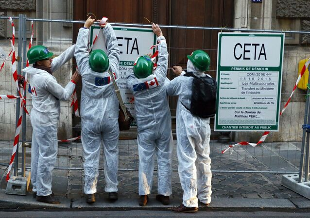 Activists demonstrate in front of French Agriculture ministry to protest against the EU trade deal with Canada, known as CETA, in Paris, Tuesday Oct. 11, 2016