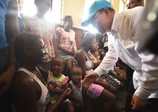 UN Secretary-General Ban Ki-moon greets victims of the Hurricane Matthew at a shelter in the Lycee Phillipe Guerrier in the city of Les Cayes, in the southwest of Haiti, on October 15, 2016.