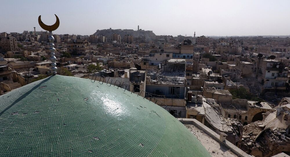 A view taken with a drone shows the minaret of Osama Bin Zayed mosque along with damaged buildings in the old city of Aleppo, Syria, October 13, 2016