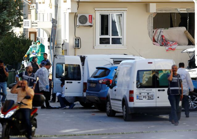 Police forensic experts examine a blast site in the southeastern city of Gaziantep, Turkey, October 16, 2016