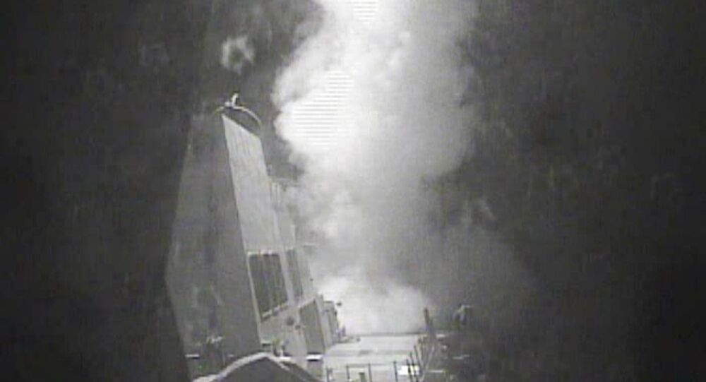 In this Thursday Oct. 13 photo released by US Navy, the guided missile destroyer USS Nitze (DDG 94) launches a strike against coastal sites in Houthi-controlled territory on Yemen's Red Sea coast