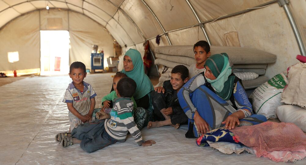 Displaced people who fled Mosul are pictured at a refugee camp in Duhok, Iraq, October 16, 2016