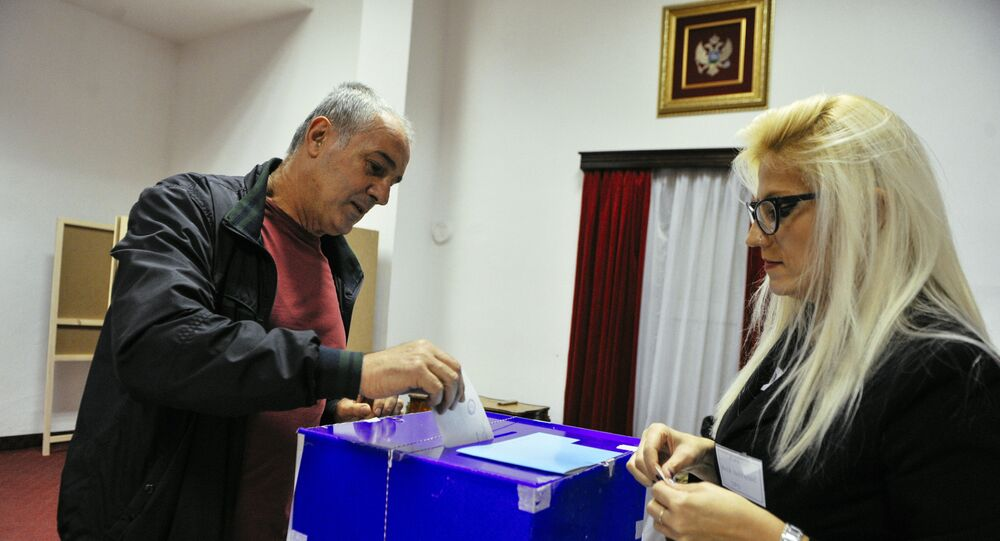 A man casts his ballot during parliamentary elections at a polling station in Podgorica on October 16, 2016. Montenegro began voting in parliamentary elections on October 16, 2016 with opposition groups hoping to end the quarter-century rule of pro-Western premier Milo Djukanovic, who warns that his rivals would derail imminent NATO accession.