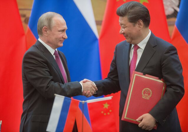 Russian President Vladimir Putin, left, and President of the People's Republic of China Xi Jinping during a signing ceremony of documents following their talks in Beijing