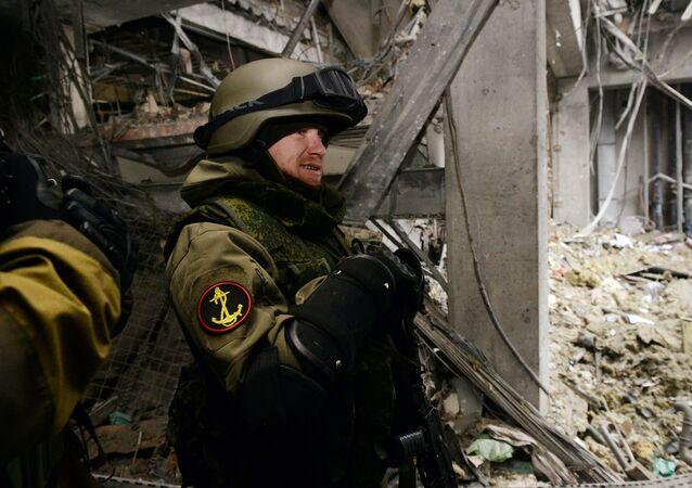 Arseny Pavlov, also known by his nickname 'Motorola', stands inside a destroyed airport building in the eastern Ukrainian city of Donetsk, on February 26, 2015