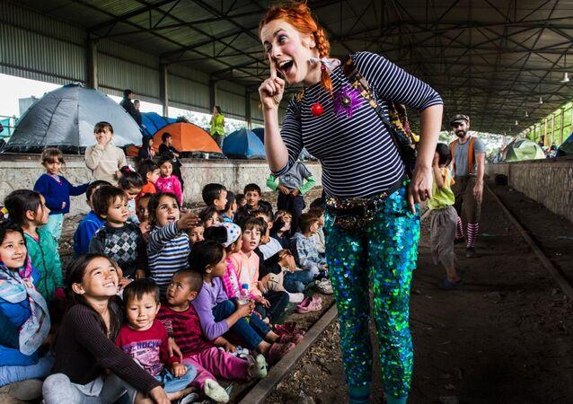 Clown Marion Duggan taken in pop-up camp in Norther Greece in May 2016