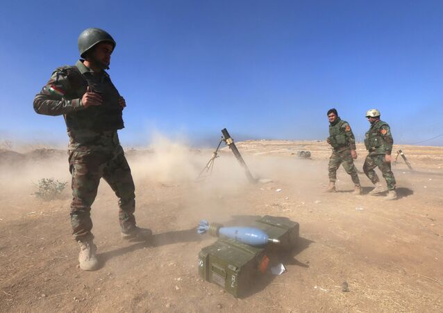 Iraqi Kurdish Peshmerga fighters fire a mortar shell from the top of Mount Zardak, about 25 kilometres east of Mosul, as they take part in an operation against Daesh jihadists, on October 17, 2016