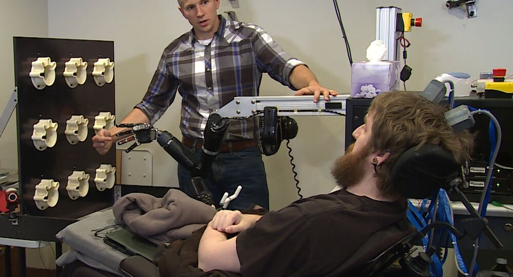 Mind-controlled robot arm enables paralyzed man in the US to feel again