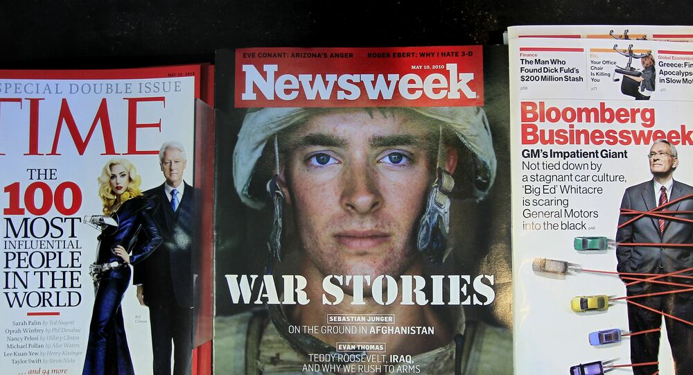 Newsweek magazine is displayed on a shelf at a news stand at South Station in Boston, Wednesday, May 5, 2010. The Washington Post Co. is putting Newsweek up for sale in hopes that another owner can figure out how to stem losses at the 77-year-old weekly magazine.