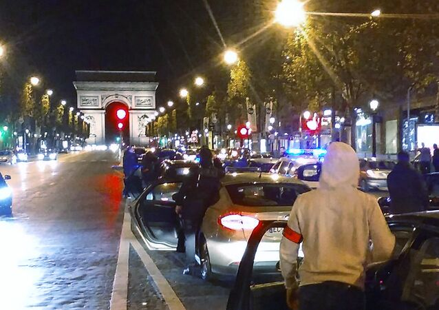 Around 500 police officers in plain clothes take part in a protest on the Champs-Elysees avenue overnight on October 18, 2016 in Paris