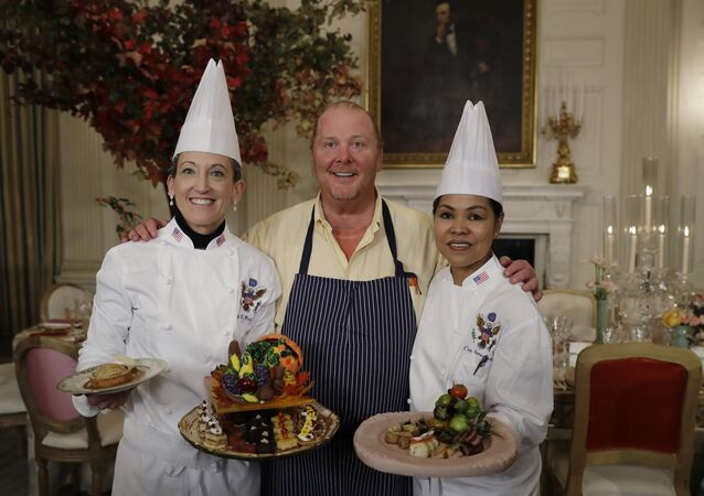 From left, White House Executive Pastry Chef Susan Morrison, American chef Mario Batali, and White House Executive Chef Cris Comerford pose for photographers during a preview in advance of the State Dinner in honor of the Official Visit of Italian Prime Minister Matteo Renzi and his wife Agnese Landini, Monday, Oct. 17, 2016, in the State Dining Room of the White House in Washington