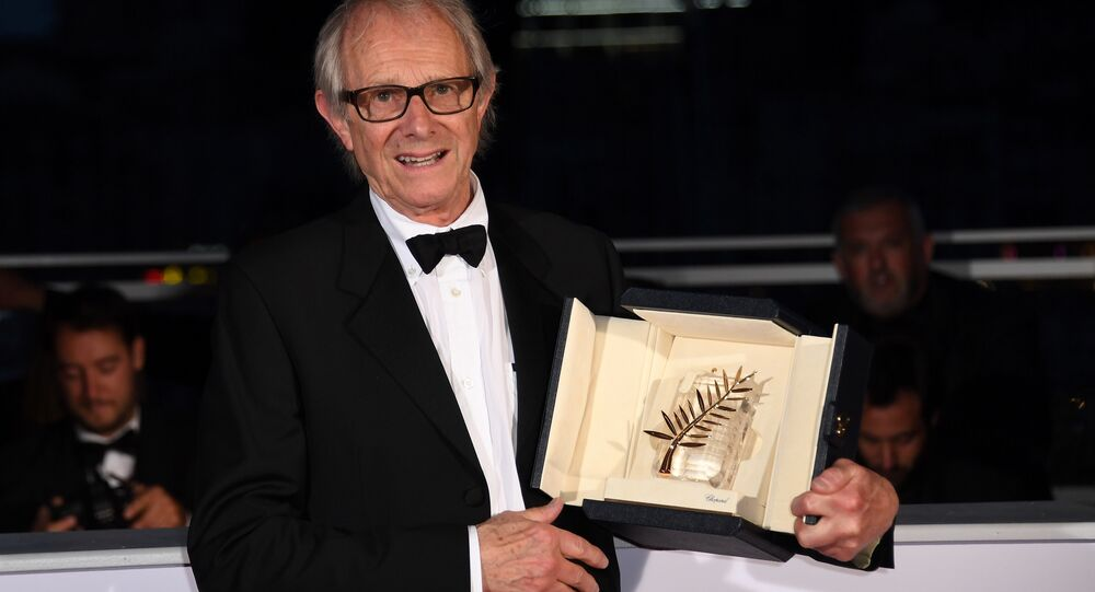British director Ken Loach poses after he was awarded the Palme d'Or for the film I, Daniel Blake on May 22, 2016 during a photocall at 69th Cannes Film Festival in Cannes, southern France.