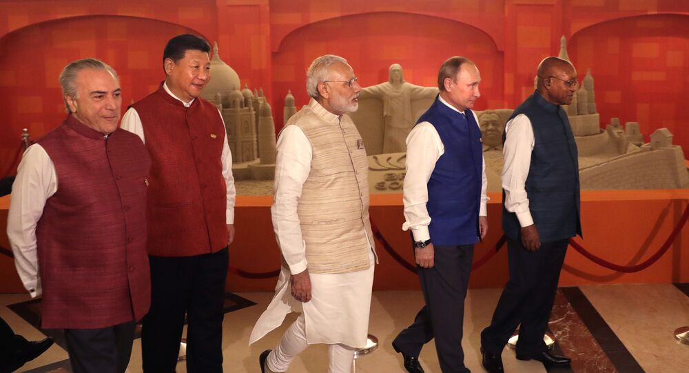 Leaders of BRICS nations, from left, Brazilian President Michel Temer, Chinese President Xi Jinping, Indian Prime Minister Narendra Modi, Russian President Vladimir Putin and South African President Jacob Zuma walk past sand sculptures of famous landmarks of BRICS nations created by Indian sand artist Sudarsan Pattnaik, prior to dinner hosted by Modi in Goa, India, Saturday, Oct. 15, 2016