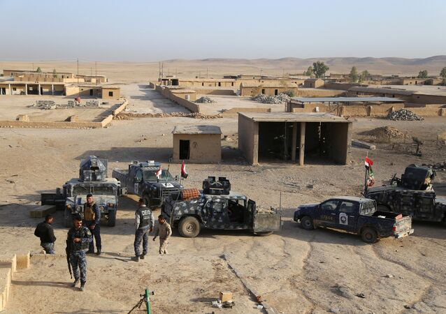 Iraqi security forces gather in Qayara, south of Mosul, to attack Islamic State militants in Mosul, Iraq, October 18, 2016