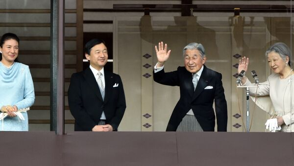 Japan's Emperor Akihito (2nd R) and Empress Michiko (R) wave to well-wishers while Crown Prince Naruhito (2nd L) and his wife Crown Princess Masako (L) look on, during their new year greetings in Tokyo on January 2, 2015. - Sputnik International