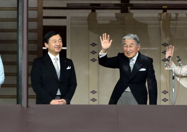 Japan's Emperor Akihito (2nd R) and Empress Michiko (R) wave to well-wishers while Crown Prince Naruhito (2nd L) and his wife Crown Princess Masako (L) look on, during their new year greetings in Tokyo on January 2, 2015.