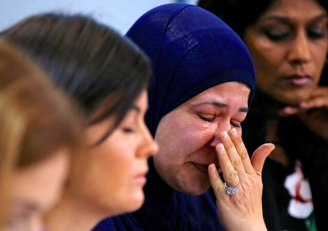 A relative of asylum seekers, currently being held on the tiny south Pacific island of Nauru, known only as 'Fida', cries during a media conference to officially launch rights group Amnesty International's report titled 'Island of Despair - Australia's Processing of Refugees on Nauru' in Sydney, Australia, October 18, 2016.