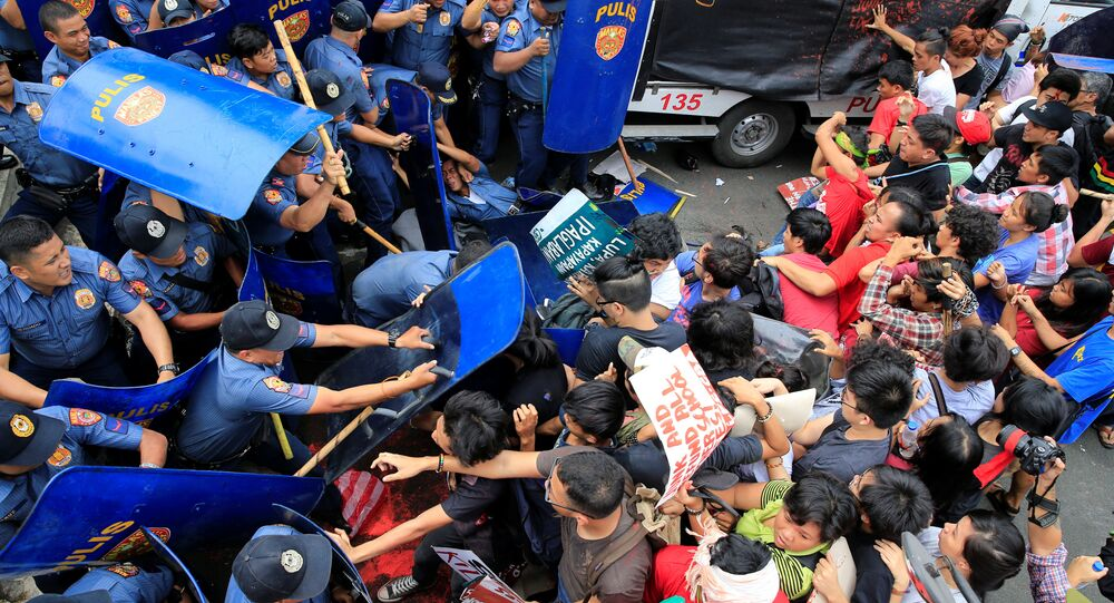 Various activist and Indigenous People's (IP) groups clash with anti-riot policemen during a protest against the continuing presence of U.S. troops in the Philippines in front of the U.S. Embassy in metro Manila, Philippines October 19, 2016.