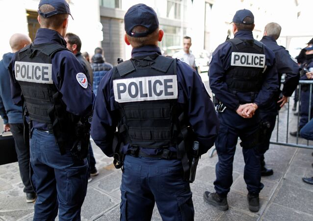 French police gather outside a local police station in Paris, France, October 11, 2016, after a Molotov cocktail attack over the weekend near Paris that injured their colleagues.