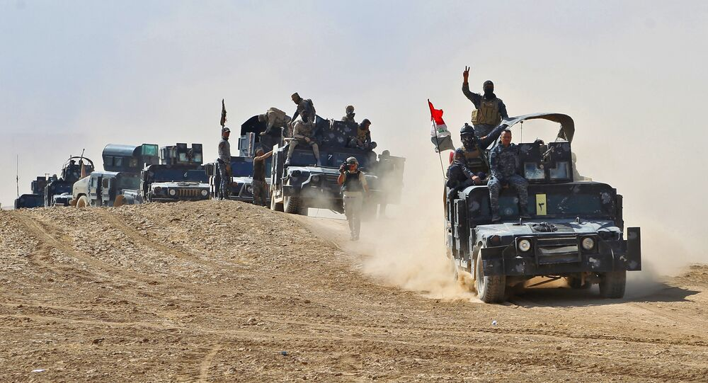 Iraqi forces hold a position near the village of Tall al-Tibah, some 30 kilometres south of Mosul during an operation against Islamic State (IS) group jihadists to retake the main hub city